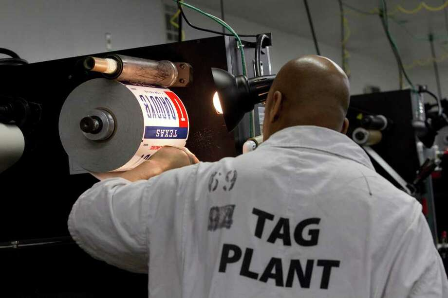 Randy Wilson runs a personal license plate printer at the Wynne Unit Monday, March 26, 2012, in Huntsville. Photo: Brett Coomer, Houston Chronicle / © 2012 Houston Chronicle