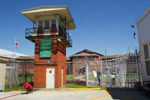 The front gate of the Wynne Unit is shown Monday, March 26, 2012, in Huntsville. The Wynne Unit is the home to several Texas Correctional Industries plants, which provide a variety of goods for use throughout the Texas Department of Criminal Justice and other state agencies. There are 5,200 inmates assigned to TCI in 37 factories statewide.