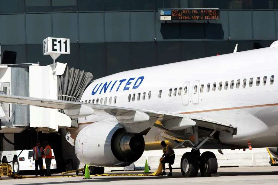 Each passenger category is assigned a number for boarding at the merged Continental and United. Photo: Brett Coomer / Houston Chronicle