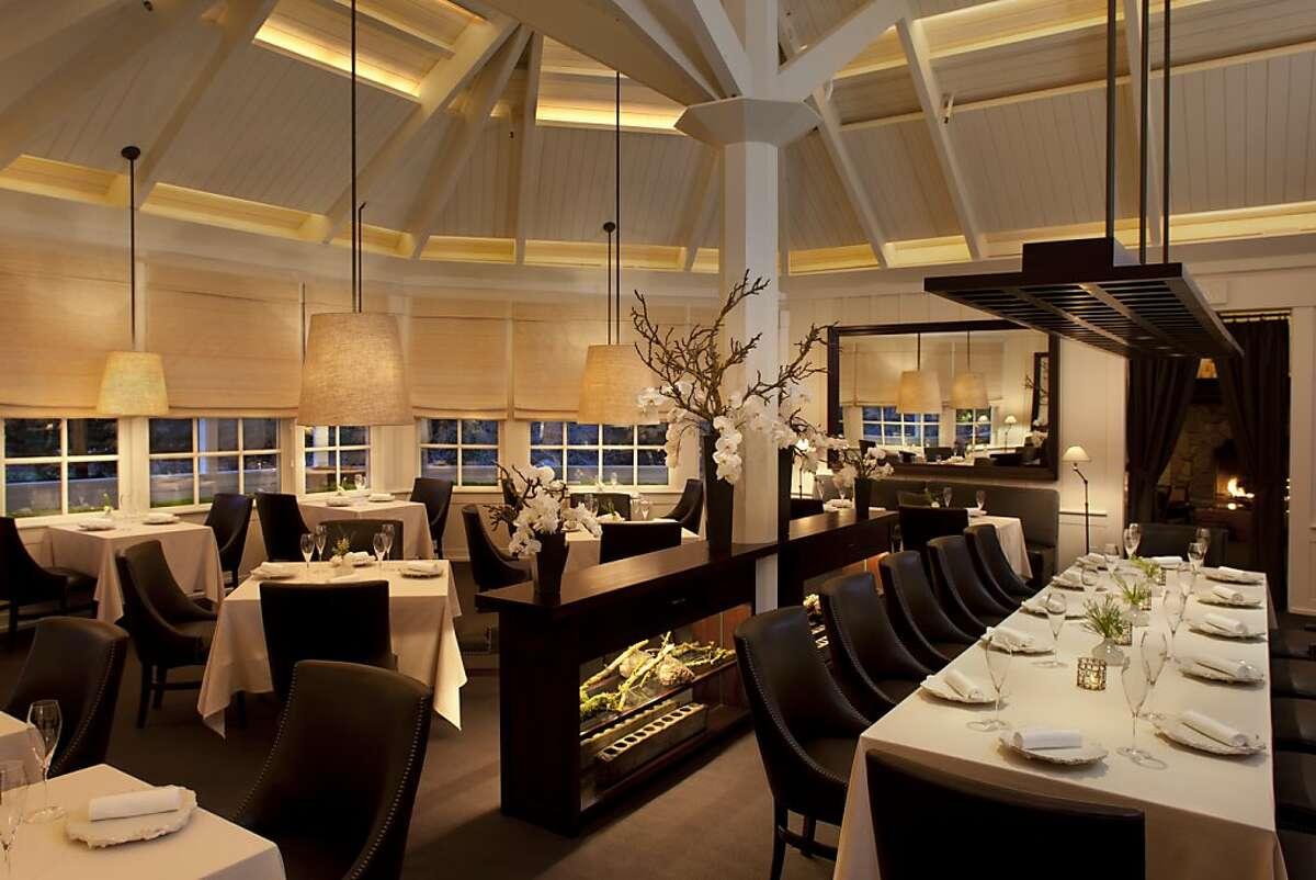 Main dining room of the Meadowood Resort Restaurant at dusk.