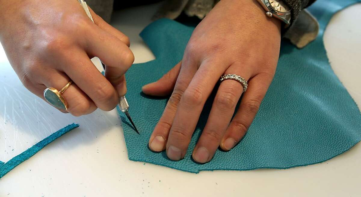 A student of master leather artisan, Bea Amblard cuts out a pattern during a class on leather working at April in Paris, a leather store in San Francisco Wednesday, Jan. 18, 2012.