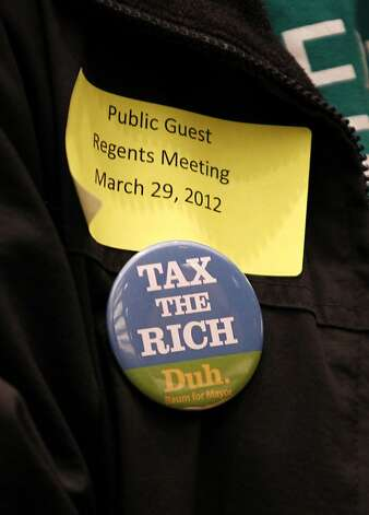 "A woman wears a button depicting ""Tax the Rich, Duh"" before UC Regents suspended their meeting at the William J. Rutter Center on UCSF Mission Bay Campus, on Thursday, March 29, 2012 in San Francisco, Calif. Photo: Beck Diefenbach, Special To The Chronicle"