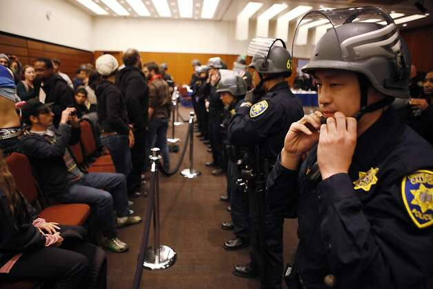 University of California Police don helmets before evacuating the UC Regents meeting at the William J. Rutter Center on UCSF Mission Bay Campus, on Thursday, March 29, 2012 in San Francisco, Calif. Photo: Beck Diefenbach, Special To The Chronicle