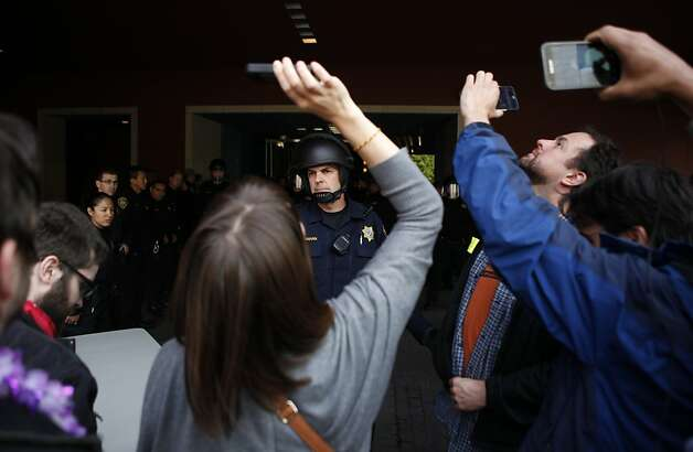 University of California Police keep demonstrators from reentering the building after UC Regents suspended their meeting at the William J. Rutter Center on UCSF Mission Bay Campus, on Thursday, March 29, 2012 in San Francisco, Calif. Photo: Beck Diefenbach, Special To The Chronicle