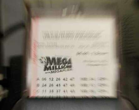 A Mega Millions jackpot lotto ticket is printed out for a customer Thursday, March 29, 2012, in Indianapolis. (AP Photo/Darron Cummings) Photo: Darron Cummings, Wire / AP