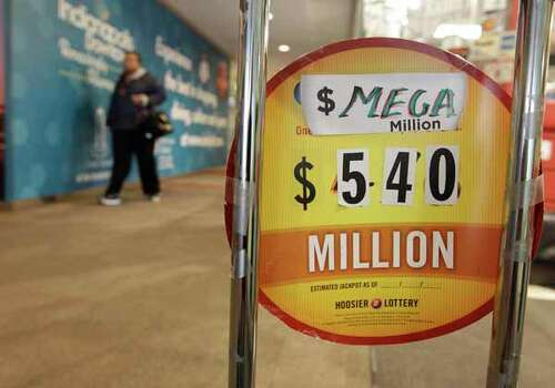 A sign is posted in front of Kanti's with the estimated value of the Mega Millions jackpot Thursday, March 29, 2012, in Indianapolis. (AP Photo/Darron Cummings) Photo: Darron Cummings, Wire / AP