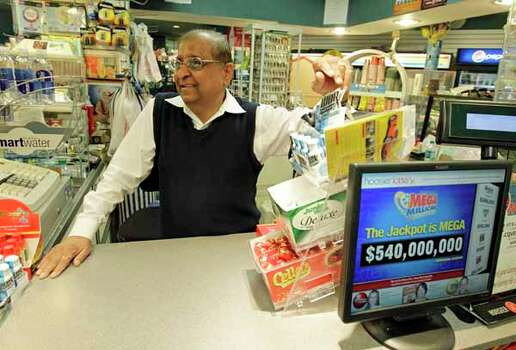 Suresh Kheradiya talks about the increase of sales in the Mega Millions tickets from his store Thursday, March 29, 2012, in Indianapolis. (AP Photo/Darron Cummings) Photo: Darron Cummings, Wire / AP