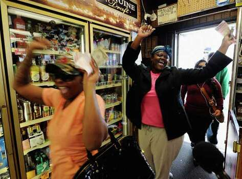 HAWTHORNE, CA - MARCH 29:  Tammy Redlen (C) and Sierra Luchien (L) are jubilant as they walk in Blue Bird liquor store after waiting in line for nearly three hours to purchase their Mega Millions lottery ticket on March 29, 2012 in Hawthorne, California. The Mega Millions jackpot has reached a record high of $540 million.  (Photo by Kevork Djansezian/Getty Images) Photo: Kevork Djansezian, Wire / 2012 Getty Images