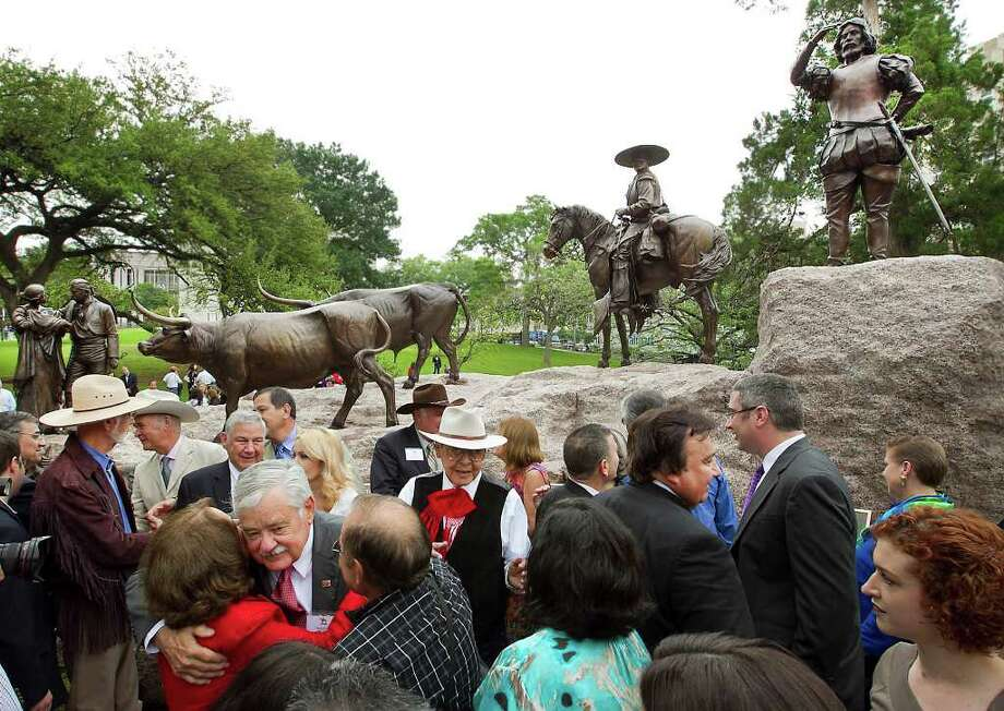 The ceremonial unveiling of the Tejano Monument was held on the south lawn of the Texas State Capitol with many dignitaries and special guests who were instrumental in the creation and funding of the legacy sculpture. Photo: Ralph Barrera, Austin American-Statesman / Austin American-Statesman