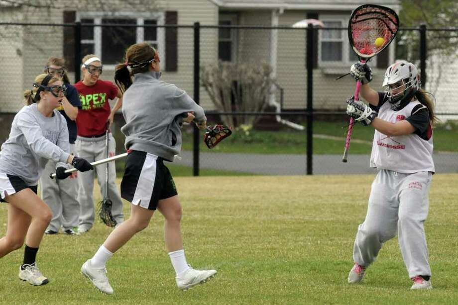 The Niskayuna High School girls' lacrosse team practices in Niskayuna N.Y., Wednesday March 28, 2012. (Michael P. Farrell/Times Union) Photo: Michael P. Farrell