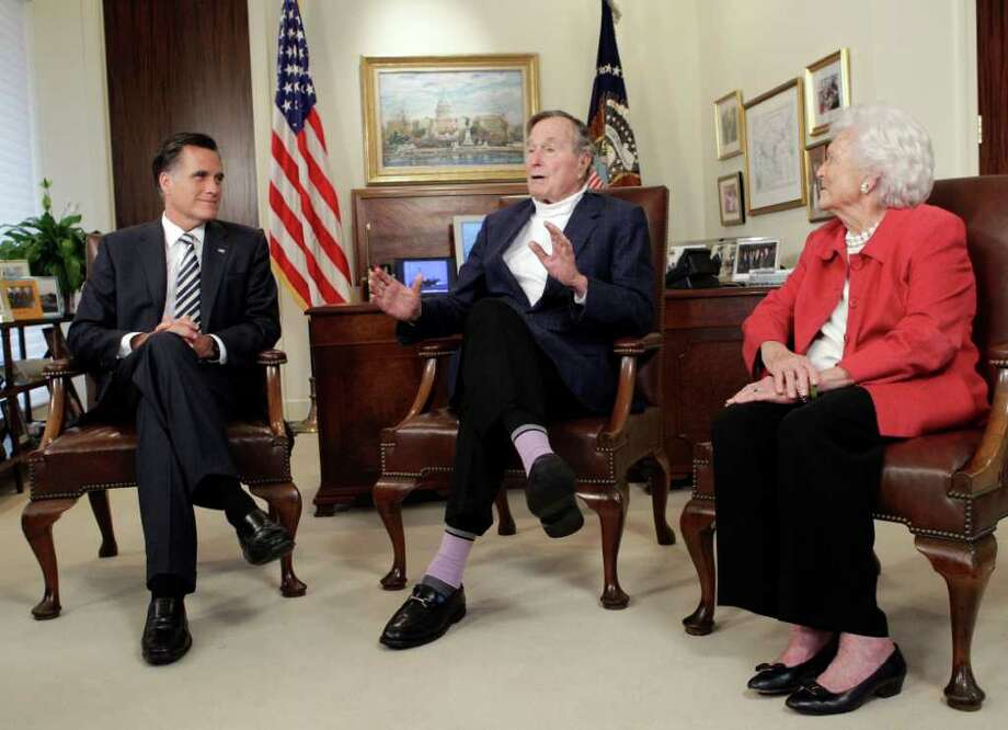Mitt Romney receives an endorsement Thursday from former President George H.W. Bush and Barbara Bush during a news conference at Bush's office. Photo: Melissa Phillip / © 2012 Houston Chronicle