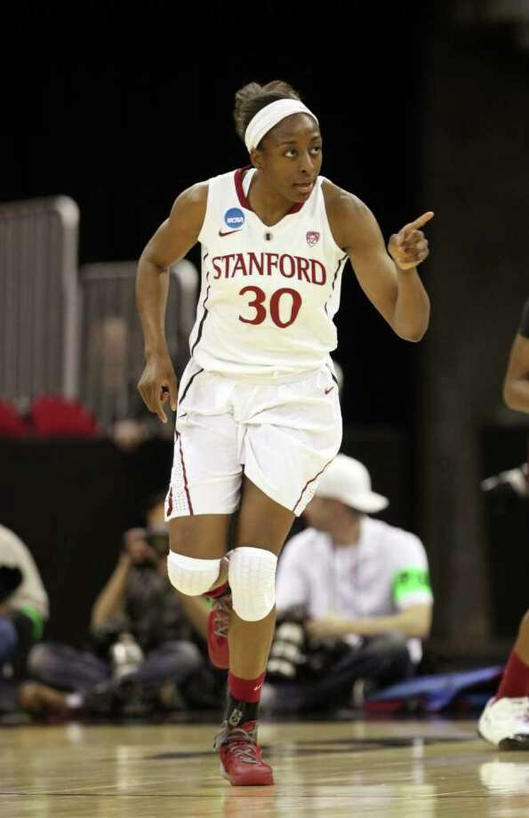 Stanford's Nnemkadi Ogwumike gestures after scoring against South Carolina during the first half of an NCAA women's tournament regional semifinal college basketball game,  Saturday, March 24, 2012, in Fresno, Calif. The winner will play Duke Monday in the regional finals.(AP Photo/Rich Pedroncelli) Photo: Rich Pedroncelli / AP