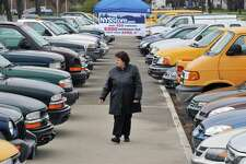 NYS OGS Commissioner RoAnn Destito looks over more than 450 cars, trucks, SUVs, and vans located in two lots at the Harriman Campus Thursday March 29, 2012. The state owned vehicles will be auctioned on eBay starting April 3.  (John Carl D'Annibale / Times Union)