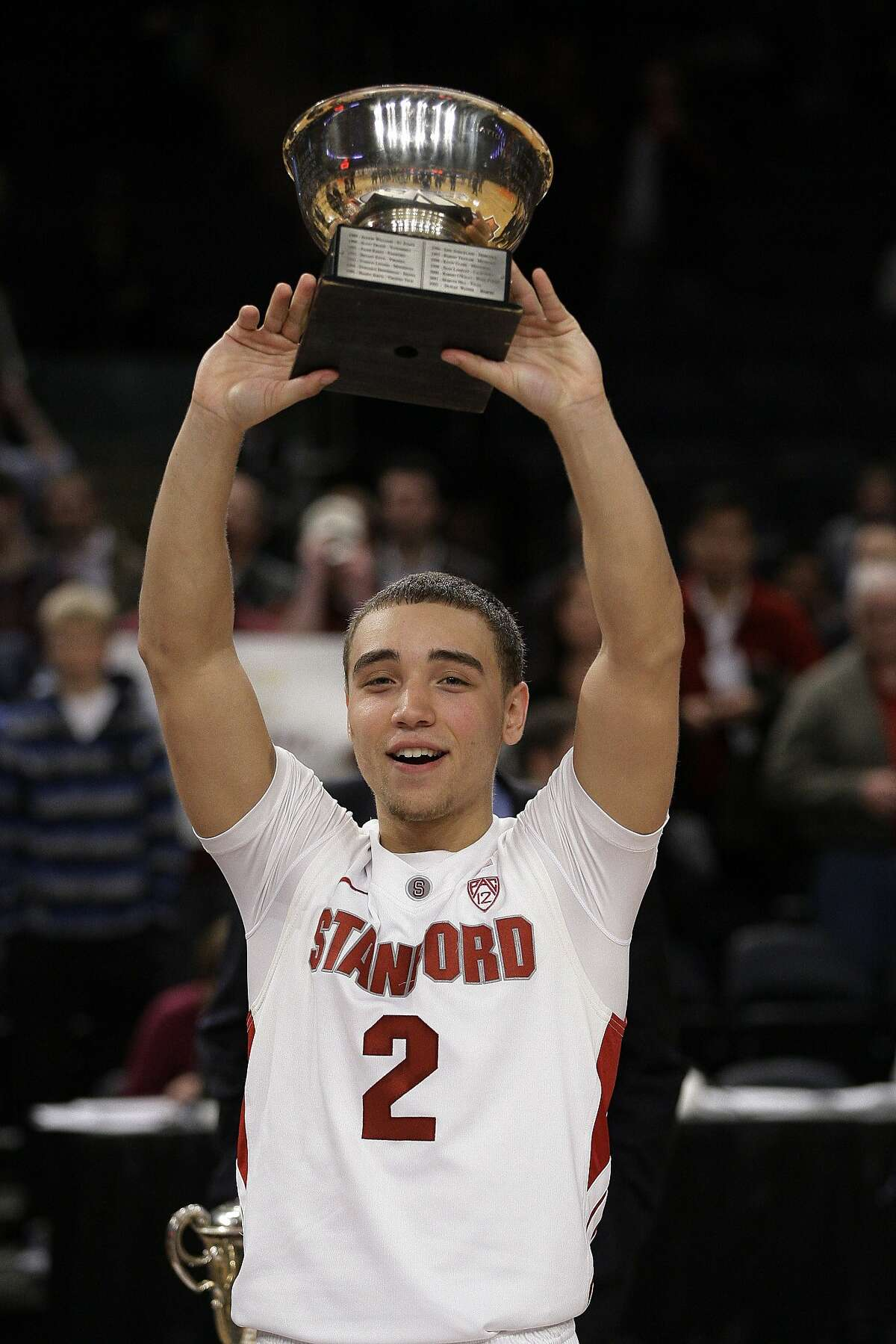Stanford's Aaron Bright poses for photographs with the Most Outstanding Player trophy during the second half of the NIT college basketball tournament final against Minnesota, Thursday, March 29, 2012, in New York. Stanford won the game 75-51. (AP Photo/Frank Franklin II)