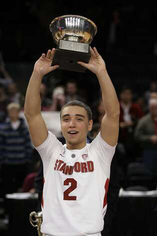 Stanford's Aaron Bright poses for photographs with the Most Outstanding Player trophy during the second half of the NIT college basketball tournament final against Minnesota, Thursday, March 29, 2012, in New York. Stanford won the game 75-51. (AP Photo/Frank Franklin II) Photo: Frank Franklin II, Associated Press