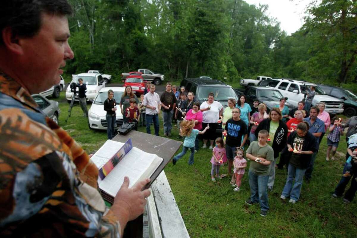The Rev. Don Knox Jr. speaks Thursday at a vigil at Cleveland's Davis Hill Baptist Church for the missing tot.