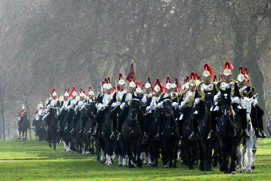 Members of the Household Cavalry Mounted Regiment parade on their horses during the Major General's inspection at Hyde Park in central London, on March 28, 2012 which they must pass to take part in state ceremonial activites in 2012. Soldiers from the iconic Household Cavalry Mounted Regiment will escort the Queen during her diamond jubilee procession on June 5 as well as other ceremonial duties during the London 2012 Olympic Games. Photo: MIGUEL MEDINA, AFP/Getty Images / AFP