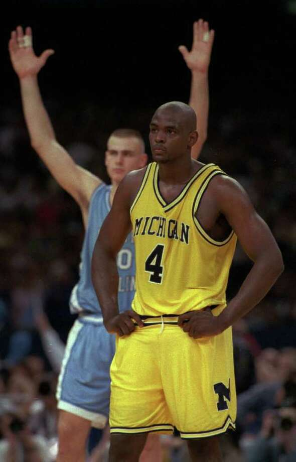 Michigan's Chris Webber (right) can only watch after his costly technical foul helped North Carolina claim a national title in 1993. Photo: AP