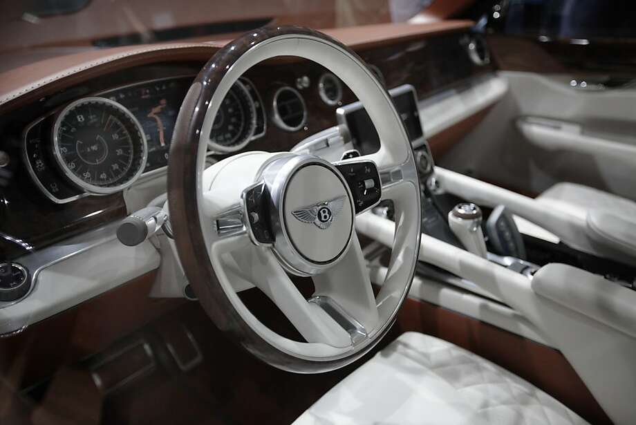 The steering wheel of a Bentley SUV automobile, produced by Bentley Motors Ltd., is seen during the first press day of the Geneva International Motor Show in Geneva, Switzerland, on Tuesday, March 6, 2012. The 82nd Geneva International Motor Show will showcase the latest models from the auto industry's leading manufacturers at the Palexpo exhibition centre this week. Photographer: Jason Alden/Bloomberg Photo: Jason Alden, Bloomberg