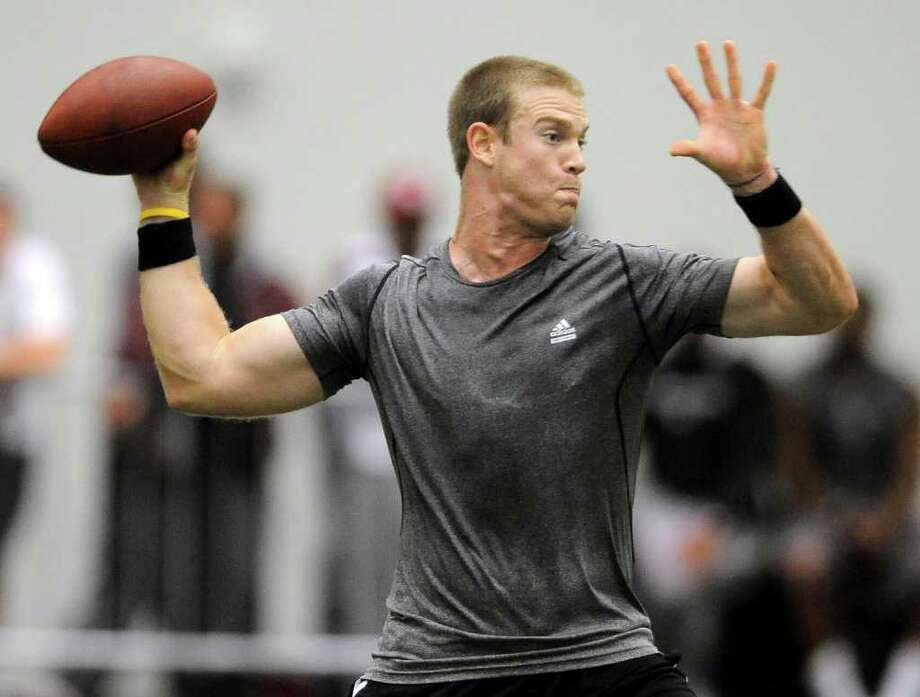 Texas A&M quarterback Ryan Tannehill could find himself competing against former Longhorns standout Colt McCoy should he be drafted by the Browns. Photo: Dave McDermand / Bryan-College Station Eagle