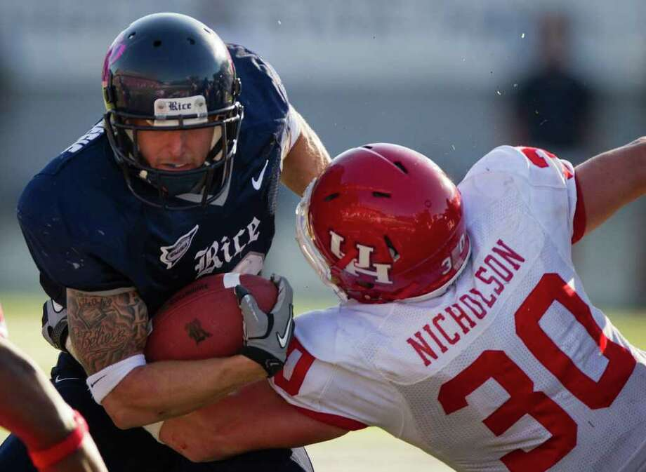 Rice running back Sam McGuffie is poised to give opposing defensive coordinators fits when he lines up at wide receiver next season. McGuffie was the Owls' leader in rushing yards (883) and receptions (39) in 2010. Photo: Smiley N. Pool / Houston Chronicle