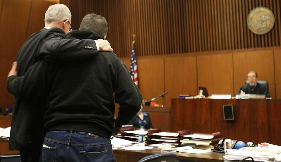 Attorney Mark DeWit, left, puts his arms around a veteran whom had been doing well in his program, in Judge Michael Tynan courtroom, at the Clara Shortridge Foltz Criminal Justice Center in  Los Angeles, California, January 30, 2012. (Francine Orr/Los Angeles Times/MCT) Photo: Francine Orr, McClatchy-Tribune News Service