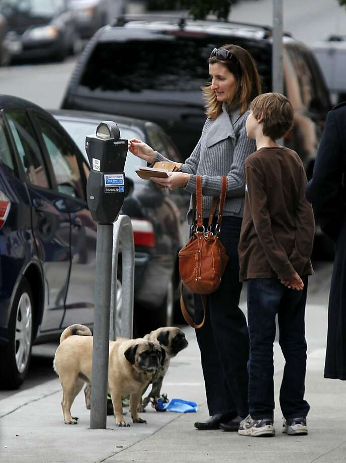 Motorists pay a parking meter on Carl Street near Cole Street on Thursday, March 29, 2012 in San Francisco, Calif. Photo: Beck Diefenbach, Special To The Chronicle