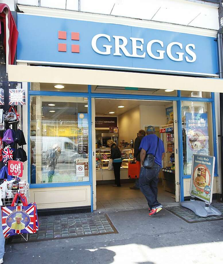 "A man walks into a branch of Greggs - a chain of bakers and makers of snack food in London, Wednesday, March, 28, 2012. The boss of Greggs has accused Britain's Chancellor of the Exchequer, George Osborne, of having ""lost touch"" after the Chancellor admitted he could not remember the last time he bought a pasty from the baker. Chief executive Ken McMeikan said ministers did not appreciate the impact changes to VAT rules would have on ordinary people. The high street chain saw millions wiped off its shares after the Budget closed a loophole that has meant some hot takeaway foods, such as sausage rolls and pasties, escaped the duty. The move - quickly dubbed the ""pie tax"" - sparked outrage, with critics pointing to the contrast of a cut in the 50p top tax rate. Photo: Alastair Grant, Associated Press"