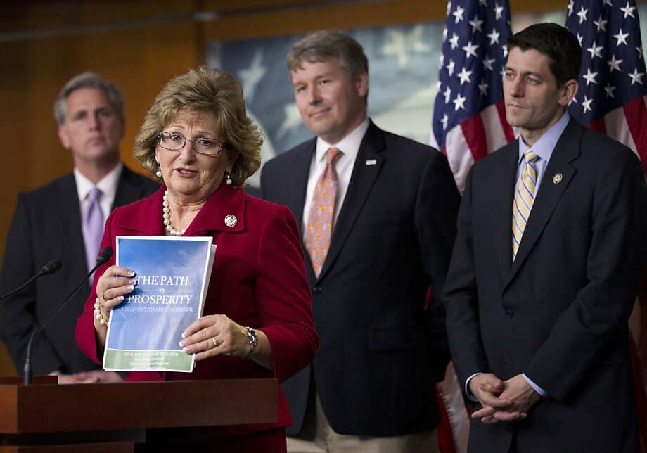 Rep. Diane Black, R-Tenn., second from left, holds a copy of the GOP budget during a news conference on Capitol Hill in Washington, Thursday, March 29, 2012. From left are, House Majority Whip Rep. Kevin McCarthy of Calif., Black, Rep. Rob Woodall, R-Ga., and House Budget Chairman Rep. Paul Ryan, R-Wis. Photo: Manuel Balce Ceneta, Associated Press
