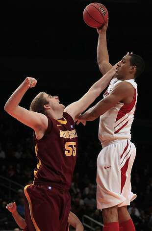 Stanford's Josh Owens, right, shoots ove Minnesota's Elliott Eliason (55) during the first half of the NIT college basketball tournament final on Thursday, March 29, 2012, in New York. Photo: Frank Franklin II, Associated Press