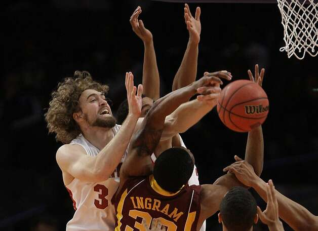 Stanford's Andrew Zimmermann (34) fights for a rebound with Minnesota's Andre Ingram (30) during the first half of the NIT college basketball tournament final on Thursday, March 29, 2012, in New York. Photo: Frank Franklin II, Associated Press