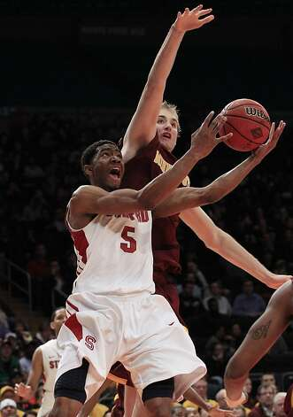 Stanford's Chasson Randle (5) drives past Minnesota's Elliott Eliason during the first half of the  NIT college basketball tournament final on Thursday, March 29, 2012, in New York. Photo: Frank Franklin II, Associated Press