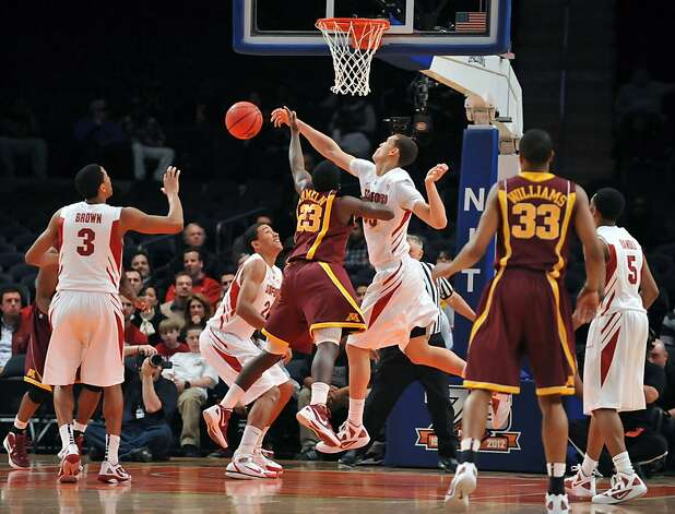 "Dwight Powell #33 of the Stanford Cardinal blocks Gerald ""Chip"" Aremelin #23 of the Minnesota Golden Golphers shot in the first half during the NIT men's basketball championship at Madison Square Garden on March 29, 2012 in New York City. Photo: Jason Szenes, Getty Images"