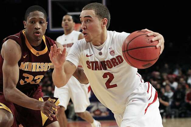 Stanford's Aaron Bright (2) drives past Minnesota's Rodney Williams (33) during the first half of the NIT college basketball tournament final, Thursday, March 29, 2012, in New York. Stanford won 75-51. Photo: Frank Franklin II, Associated Press