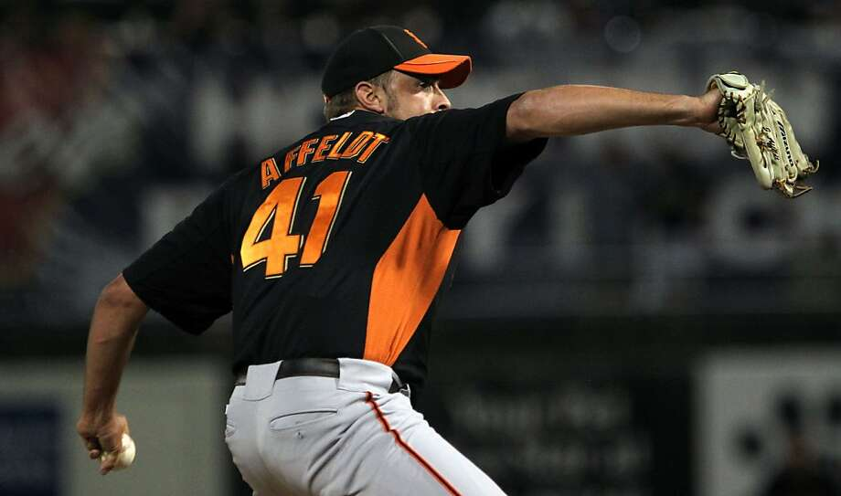 San Francisco Giants pitcher Jeremy Affeldt throws to the Texas Rangers during the ninth inning of their spring training baseball game Thursday, March 29, 2012 in Surprise, Ariz. The Giants won 6-2. Photo: Lance Iversen, The Chronicle
