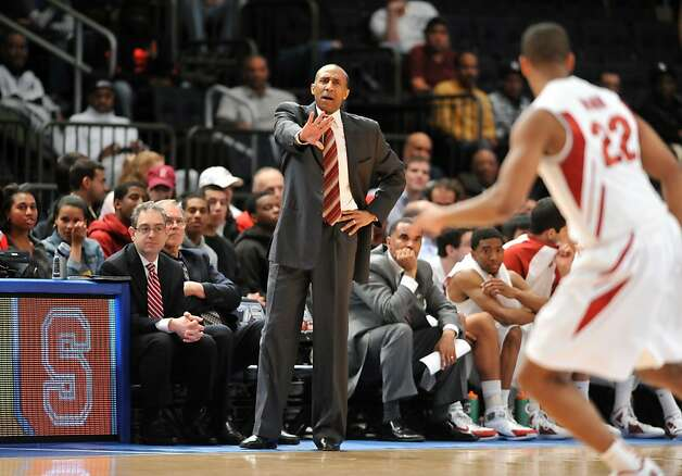 Head Coach Johnny Dawkins of the Stanford Cardinals (L) yells out instructions to Jarrett Mann #22 during his teams game against the Minnesota Golden Golphers in the second half during the NIT men's basketball championship at Madison Square Garden on March 29, 2012 in New York City. Photo: Jason Szenes, Getty Images
