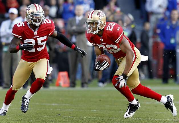 The 49ers Carlos Rogers picks up some yardage after an interception in the second half. The San Francisco 49ers defeated the New York Giants 27-20 Sunday November 13, 2011 at Candlestick Park. Photo: Brant Ward, The Chronicle