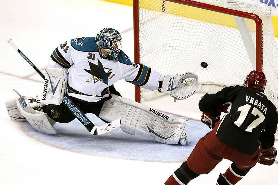 Phoenix Coyotes' Radim Vrbata (17), of the Czech Republic, scores on San Jose Sharks' Antti Niemi (31), of Finland, during the third period in an NHL hockey game Thursday, March 29, 2012, in Glendale, Ariz.  The Coyotes defeated the Sharks 2-0.(AP Photo/Ross D. Franklin) Photo: Ross D. Franklin, Associated Press