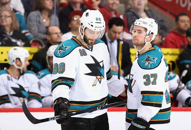 Brent Burns #88 and T.J. Galiardi #37 of the San Jose Sharks talk during a break from the second period of the NHL game against the Phoenix Coyotes at Jobing.com Arena on March 29, 2012 in Glendale, Arizona. Photo: Christian Petersen, Getty Images