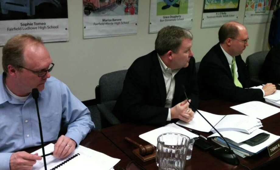 Board of Finance members, from left, Kevin Kiley, Chairman Thomas Flynn and Robert Bellitto Jr., at Thursday night meeting where a $273.3 million budget was backed for 2012-13. Photo: Andrew Brophy / Fairfield Citizen contributed