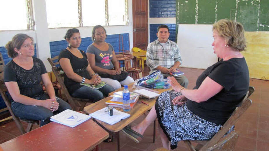 With many years as a preschool teacher-administrator, Priscilla Woyke of New Canaan, shown giving some workshop advice to educational staff in Nicaragua, has been dedicated to improving the lives of the school children in the Sister City Project through seminars and fundraising for needed items. Photo: Contributed Photo