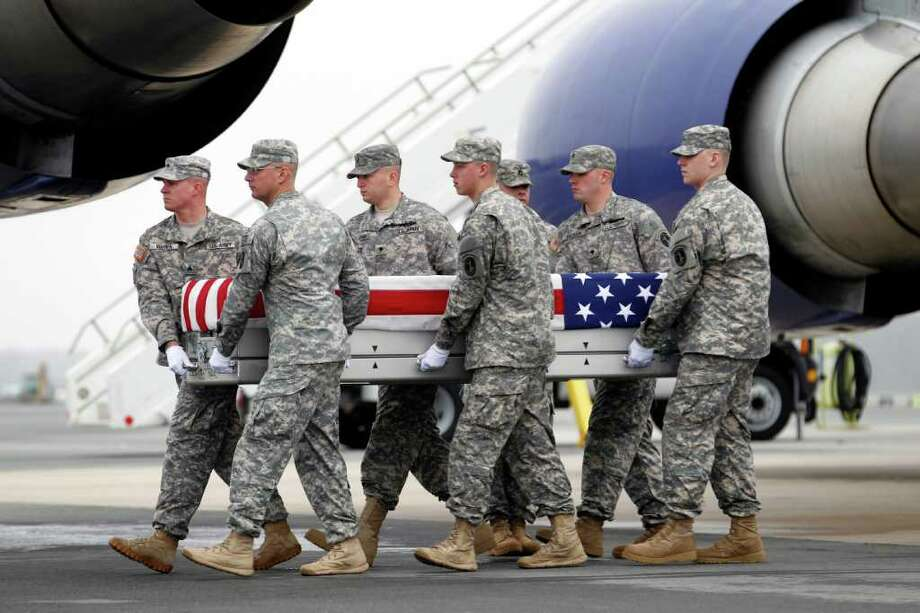 An Army carry team carries the transfer case containing the remains of Army Spc. Dennis P. Weichel, Jr. of Providence, R.I., upon arrival at Dover Air Force Base, Del., on Sunday, March 25, 2012. The Department of Defense announced the death of Weichel, who was supporting Operation Enduring Freedom in Afghanistan. Photo: AP