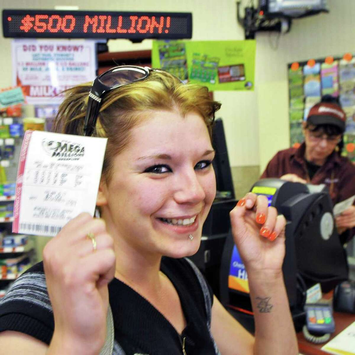 Jamie Mobeus of Colonie buys her Mega Millions ticket at a Stewarts store in Saratoga Springs Wednesday March 28, 2012. She hopes to spoil her son with winnings,