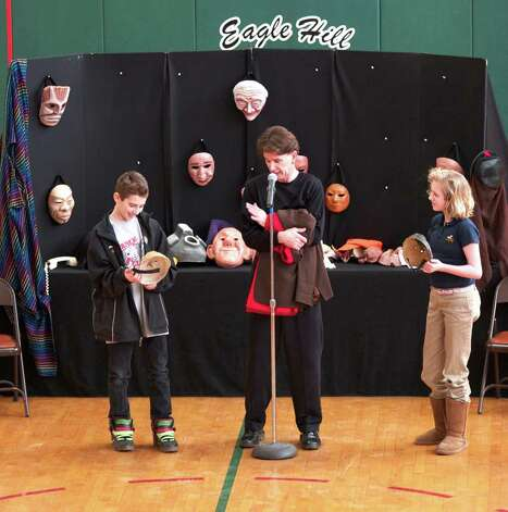 Two Eagle Hill School students join in as Faustworks Mask Theater involves them in a performance using masks, physical comedy, music, and poetry. Photo: Contributed Photo