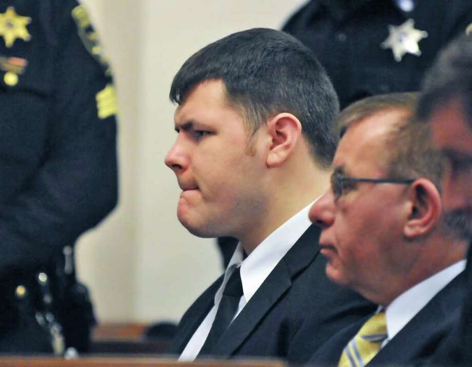 Matthew Slocum bites his lip as he is sentenced on Friday March 30, 2012, in Washington County Court in Fort Edward for the 2011 shotgun murders of his mother, stepfather and stepbrother inside their home in White Creek.   (John Carl D'Annibale / Times Union) Photo: John Carl D'Annibale / 00016964A