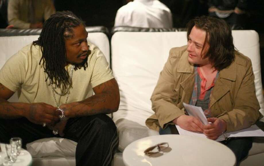 Marshawn Lynch, left,  works with actor Edward Furlong during filming of the dark comedy 'Matt's Chance' on Wednesday, March 28, 2012 at iMusic, a nightclub in downtown Seattle.  (Joshua Trujillo / seattlepi.com)