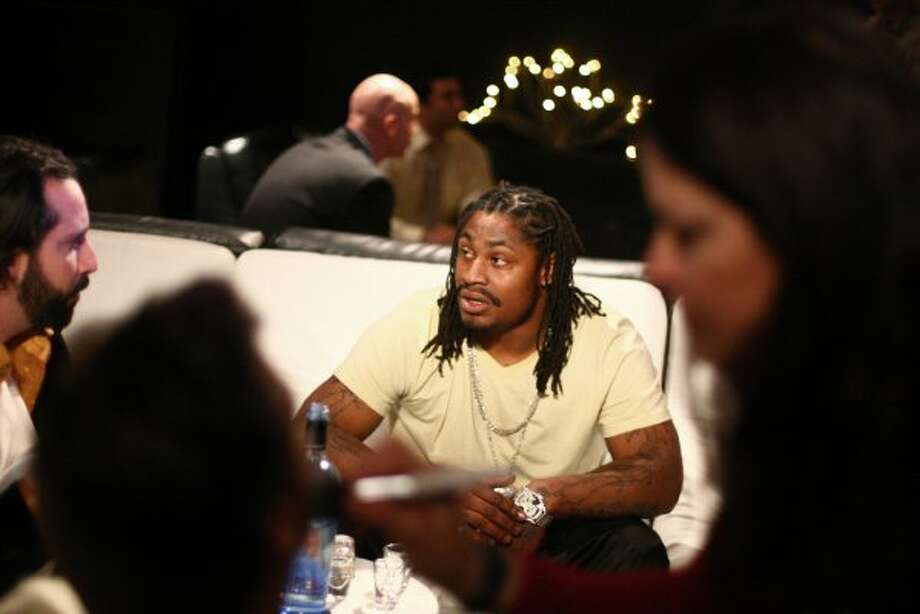 Marshawn Lynch waits as other actors get makeup applied during filming of the dark comedy 'Matt's Chance' on Wednesday, March 28, 2012, at iMusic, a nightclub in downtown Seattle. (Joshua Trujillo / seattlepi.com)