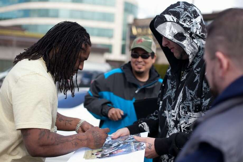 Seahawks running back Marshawn Lynch signs autographs for fans during filming of the dark comedy 'Matt's Chance' on Wednesday, March 28, 2012, at iMusic, a nightclub in downtown Seattle. (Joshua Trujillo / seattlepi.com)