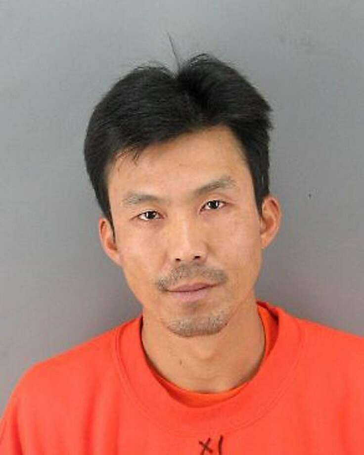 This booking photo provided by the San Francisco Police Dept. shows Binh Thai Luc, 35,  who was arrested Sunday, March 25 2012 and is being held on suspicion of five counts of murder. Luc was taken into custody in the murders of five people inside a San Francisco home Friday, in a surprise twist after police initially hinted that it was a murder-suicide case. Investigators are sorting through a crime scene that they say is so complicated that they still can't identify all the victims three days after the gruesome killings. (AP Photo/San Francisco Police Dept.) Photo: Associated Press