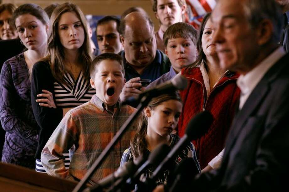 Members of the Peik family Kristen, 20; Katie, 18; Stephen, 13; Teresa and twin brother Alex, 10, listen to Ron Paul address a group of home-school supporters at the Lawrence Barn on the day before the state primary January 9, 2012 in Hollis, N.H. (Chip Somodevilla / Getty Images)